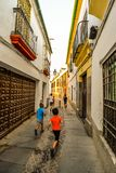The streets of Cordoba - Spain. Cordoba/ Spain - 08/20/18 - Children running the old town area of Cordoba - Spain stock photos