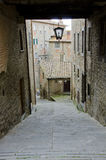 Streets of Cortona, Italy. Cortona, Italy is an ancient Etruscan hill town in Tuscany, full of narrow steep streets, intimate piazzas, stunning artwork and Royalty Free Stock Photography
