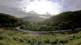 The streets curve slope in the mountain and clouds reflect sunlight in the morning at Kaeng Krachan dam in phetchaburi , Thailand.  stock footage