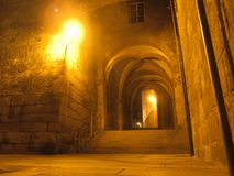 Streets of downtown at night from Santiago de Compostela in northern Spain. Medieval archway at night with luminous lanterns at the destination of the Way of St Stock Photos