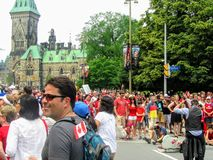 The streets of downtown Ottawa are packed with thousands of families and multicultural people celebrating Canada Day royalty free stock image