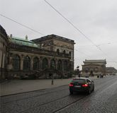 The streets of Dresden - a modern transport infrastructure against the background of historical monuments. Expensive cars and tram rails against the backdrop stock images