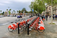 Streets and embankments of Barcelona. Red bicycles. royalty free stock photos