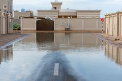 Streets flooded in the United Arab Emirates after a rainstorm stock photos