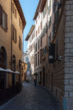 Streets of Florence, Italy. Narrow cobblestone street and old traditional buildings in Florence, Italy Stock Images