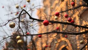 Streets fully decorated for Christmas with red and gold balls. Christmas tree in the city. House illuminated with a lot. Lights New Year theme Royalty Free Stock Photos