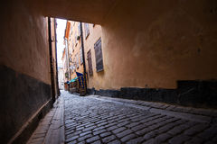 Streets of Gamla Stan, Stockholm, Sweden. Gamla Stan is an island that constitutes an old part of the Stockholm city known for its medieval houses, small cafes Royalty Free Stock Images