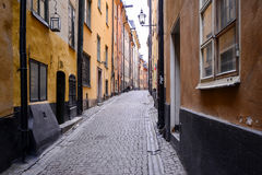 Streets of Gamla Stan, Stockholm, Sweden. Gamla Stan is an island that constitutes an old part of the Stockholm city known for its medieval houses, small cafes Royalty Free Stock Photo