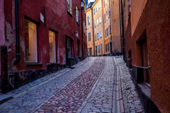 Streets of Gamla Stan, Stockholm, Sweden. Gamla Stan is an island that constitutes an old part of the Stockholm city known for its medieval houses, small cafes Stock Photo
