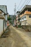 Streets of Guayaquil, Ecuador. Dirt road in the Martha de Roldos neighborhood of Guayaquil, Ecuador Royalty Free Stock Images
