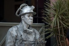 Havana, Cuba, July 2014 - Living statue of a cuban man with a miner custome stock photos