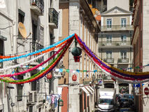 The streets of the historical neighborhood `Bairro Alto` decorated for the Popular Saints parties in Lisbon. Royalty Free Stock Image