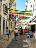 The streets of the historical neighborhood `Bairro Alto` decorated for the Popular Saints parties in Lisbon. Royalty Free Stock Photography