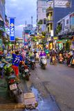 Streets of Ho Chi Minh City. Motorcycles dominating busy streets of Ho Chi Minh City, Vietnam Stock Photo