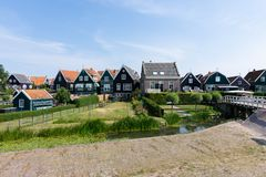 Streets and houses of Marken, Netherlands, Europe. Green gardens and blue sky on a sunny day stock photography