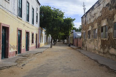 Streets of Island of mozambique. The Island of Mozambique (Portuguese: Ilha de Moçambique) lies off northern Mozambique, between the Mozambique Channel and Stock Photos