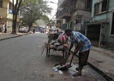 Streets of Kolkata. Street cleaner Stock Photography