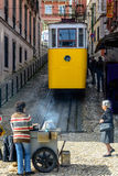 Streets in Lisbon, Portugal with yellow tram Stock Image