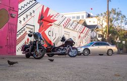 Streets of Los Angeles on Venice Beach. Motorcycles and graffiti on the walls of houses Stock Image