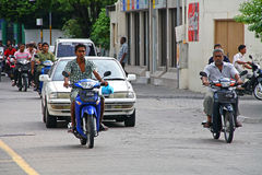 Streets of Male on Maldives. MALE, MALDIVES - JULY 1: Uknown people on streets of Male, capital city of Maldives. Transport on this small island is dominated by Royalty Free Stock Photo