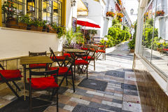 Streets of Marbella restaurant tables, Spain Stock Photo