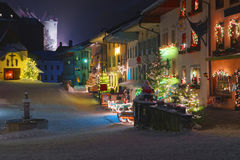 Streets of medieval town of Gruyeres decorated for Christmas Royalty Free Stock Images