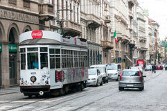 Streets of Milan, Italy. Tram with Coca Cola ads on the streets of Milan Royalty Free Stock Photography