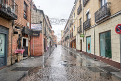 Streets, monuments and old buildings after the rain of the city Stock Photos