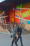 Streets of Moscow. Bar_n_grill. Hot Dog. Earth Wall Street. 24 hours Welcome Two young women Stock Photos