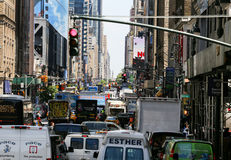 Streets of New York. New York City, USA - May 19, 2014: Many cars standing on the 8th Avenue in midtown manhattan toward central park at traffic lights. It is a Stock Photo