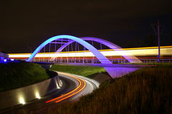 Streets at night. A beautiful futuristic bridge at night Stock Photos