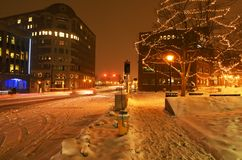 The streets of the night winter city during a snowfall. Portland. USA. Maine. stock image