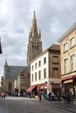 Streets of old Bruges and Church of Our Lady tower, Belgium stock photo
