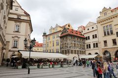 Streets of old Prague with all numerous little shops and crowds of the tourists who are looking for new impressions. Cafe and pivbara, monuments and royalty free stock photos