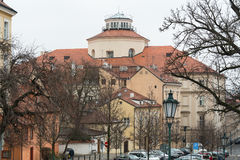 The streets of old Prague. In the background Czech Museum of Music. Stock Image