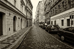 The streets of old Prague. Stylized film. Large grains. Sepia Royalty Free Stock Photography