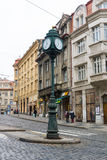 The streets of old Prague. The town clock on the pole. Crossroads. Stock Image