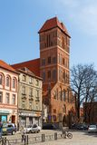 Streets of old town in Torun, Poland. Church of Saint Jacob. royalty free stock image