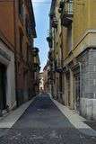 Typical small street in verona italy stock images