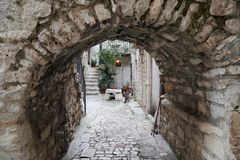 Streets of old Trogir, Croatia. TROGIR, CROATIA - SEPTEMBER 11, 2016: This is one of the streets of the old city, which is listed on the UNESCO World Heritage stock photography