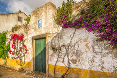 In the streets of the picturesque town of Obidos in Portugal Stock Photo