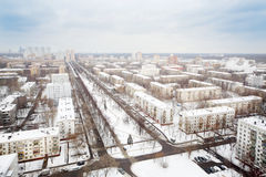 Streets and residential buildings in district at winter Stock Photos