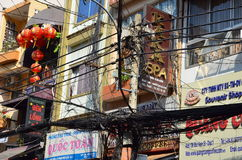 The streets of Saigon (Ho Chi Min City) full of wires. Royalty Free Stock Images