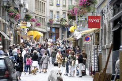 Streets of Saint-Malo. People shopping in the streets of the old village of Saint-Malo in Brittany, France. Saint-Malo is one of the most touristic cities of Royalty Free Stock Photography