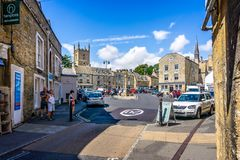 Streets and shops and market cross in historic cotswold town of Stow on the Wold. In Gloucestershire, UK on 3 August 2018 stock images