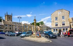 Streets and shops and market cross in historic cotswold town of Stow on the Wold. In Gloucestershire, UK on 3 August 2018 stock photos