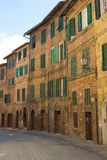 Streets of Siena with traditional houses with window shutters Stock Photos