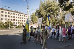 On the streets of Slavyansk people march in honor of the national flag holiday. SLOVIANSK, UKRAINE - AUGUST 23, 2015: On the streets of Slavyansk people march in stock image