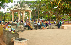 In the streets of Stone Town, Zanzibar. Zanzibar, Stone Town - 18 January 2015: a group of local Zanzibar people resting in a little square near the piers, on a Royalty Free Stock Image