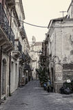 Streets in Syracuse. Typical old, narrow and dirty streets in Syracuse in Sicily, Italy Stock Photos